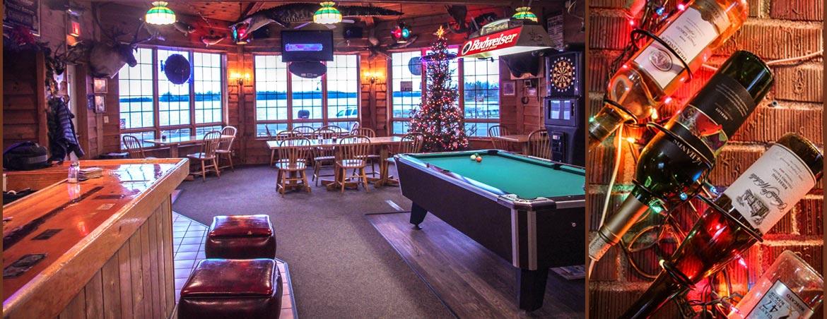 camp-28-saloon-bar-view-to-rib-lake-at-christmas-time-with-wine-bottles